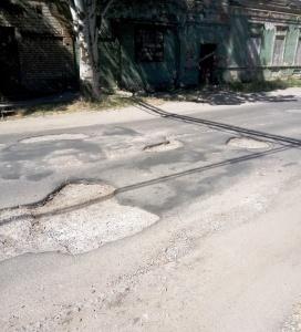 яма на дороге, ущерб